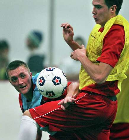 Brandon Swartzendruber (left) battles against Karsten Smith for possession of the ball as the San Antonio Scorpions hold their first practice indoors at the Northwoods on February 18, 2012 Tom Reel/ San Antonio Express-News Photo: TOM REEL, Express-News / San Antonio Express-News