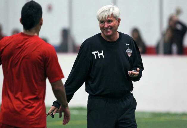 Coach Tim Hankinson chats with a player as the San Antonio Scorpions hold their first practice indoors at the Northwoods on February 18, 2012 Tom Reel/ San Antonio Express-News Photo: TOM REEL, Express-News / San Antonio Express-News