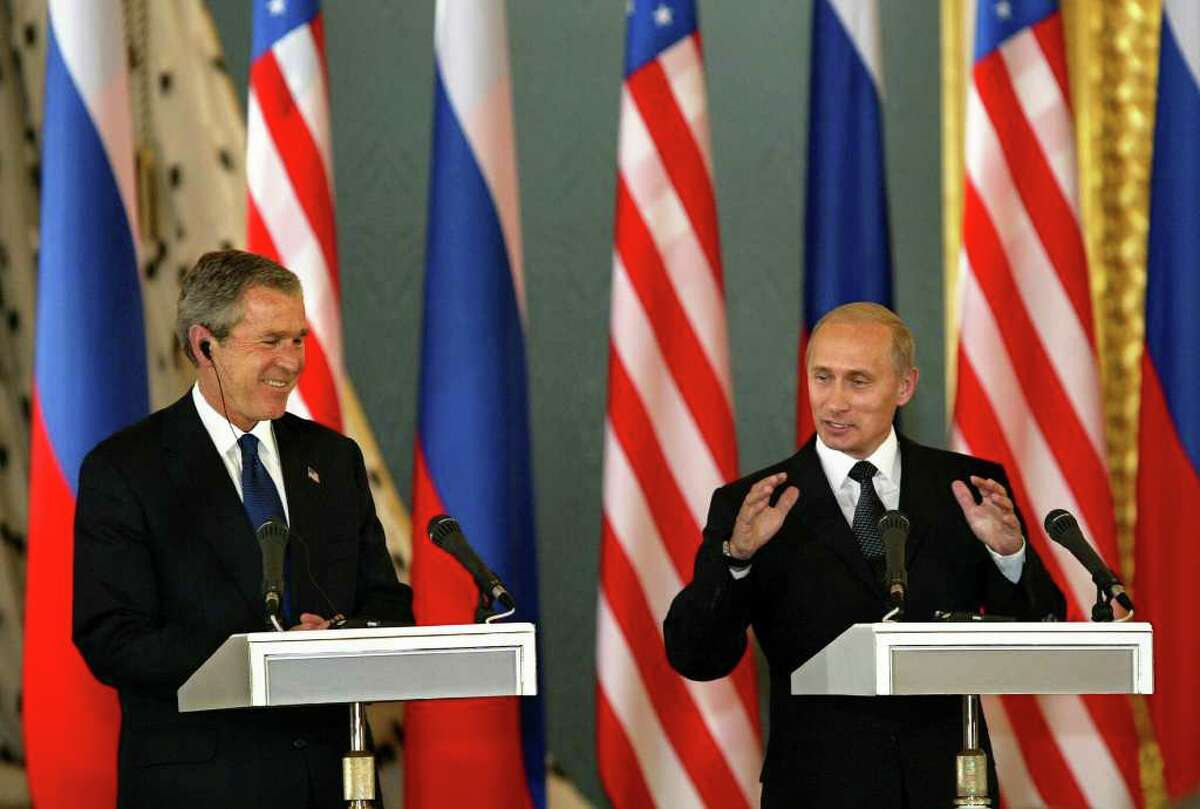 """FILE - In this May 24, 2002, file photo Russian President Vladimir Putin's remarks provoke a laugh from U.S. President Bush, left, as they finish a Kremlin news conference in Moscow after they signed a nuclear arms reduction treaty that Bush said """"liquidates the Cold War legacy of nuclear hostility"""" between Russia and America. The Obama administration's latest consideration of sharp reductions in nuclear weapons has produced a tidal wave of criticism by congressional Republicans with one lawmaker calling it """"reckless lunacy."""" But the historical record shows that in recent decades, Republicans have been boldest in shrinking the U.S. nuclear arsenal. (AP Photo/J. Scott Applewhite, File)"""