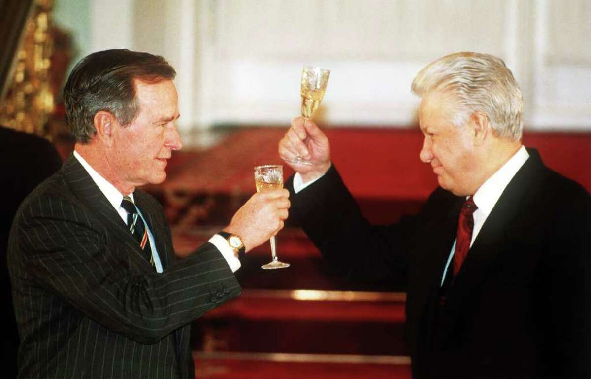 """FILE - In this Jan. 3, 1993, file photo Russian President Boris Yeltsin toasts with U. S. President George Bush, left, after they signed the START II treaty, a landmark nuclear arms control treaty calling for a two-third reduction on the world's most terrifying weapons, in Moscow's Kremlin. The Obama administration's latest consideration of sharp reductions in nuclear weapons has produced a tidal wave of criticism by congressional Republicans, with one lawmaker calling it """"reckless lunacy."""" But the historical record shows that in recent decades, Republicans have been boldest in shrinking the U.S. nuclear arsenal. (AP-Photo/Liu Heung Shing, File)"""