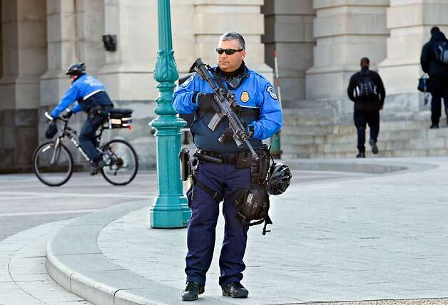 A Capitol Police officers keep watch on Capitol Hill in Washington, Friday, Feb. 17, 2012. A 29-year-old Moroccan man was arrested Friday near the U.S. Capitol as he was planning to detonate what he thought was a suicide vest, given to him by FBI undercover operatives, said police and government officials. Photo: J. Scott Applewhite, Associated Press