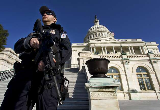 Capitol Police officer Trevor O'Neill stands on guard on the west side of the Capitol in Washington Friday, Feb. 17, 2012. A 29-year-old Moroccan man was arrested Friday in an FBI sting operation near the U.S. Capitol while planning to detonate what police say he thought were live explosives. Photo: Manuel Balce Ceneta, Associated Press