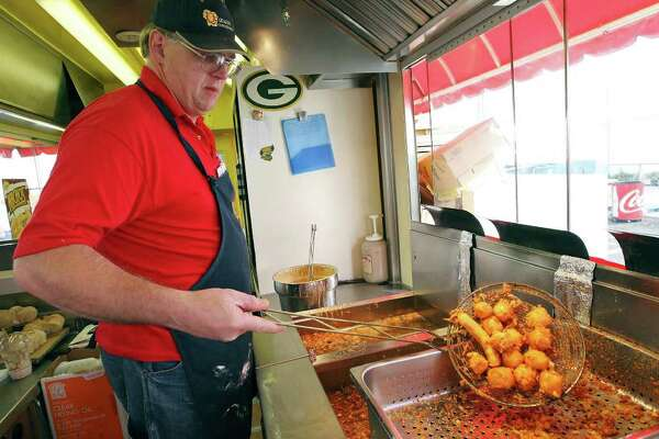 FOR METRO - Duane Hickman fries Wisconsin cheese Saturday Feb. 18, 2012 during the San Antonio Stock Show & Rodeo at the AT&T Center.