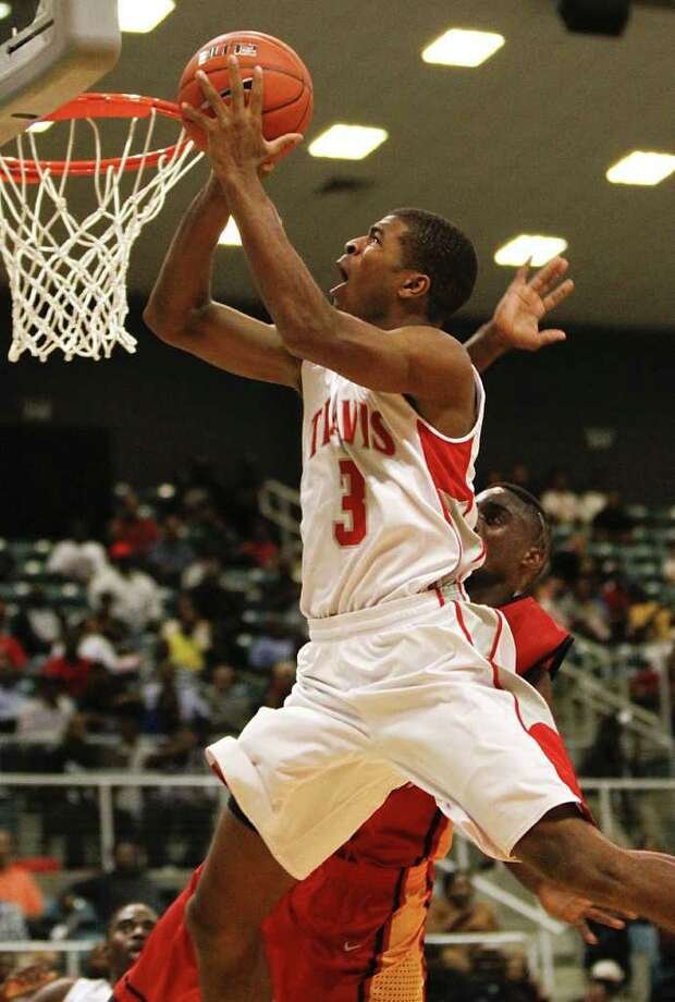 Aaron Harrison and Fort Bend Travis opened the season in November with a 77-69 win over Yates. Both teams, along with Strake Jesuit, North Shore and Bush, are among the area's best chances for a state title in boys basketball. Photo: Diana L. Porter / © Diana L. Porter