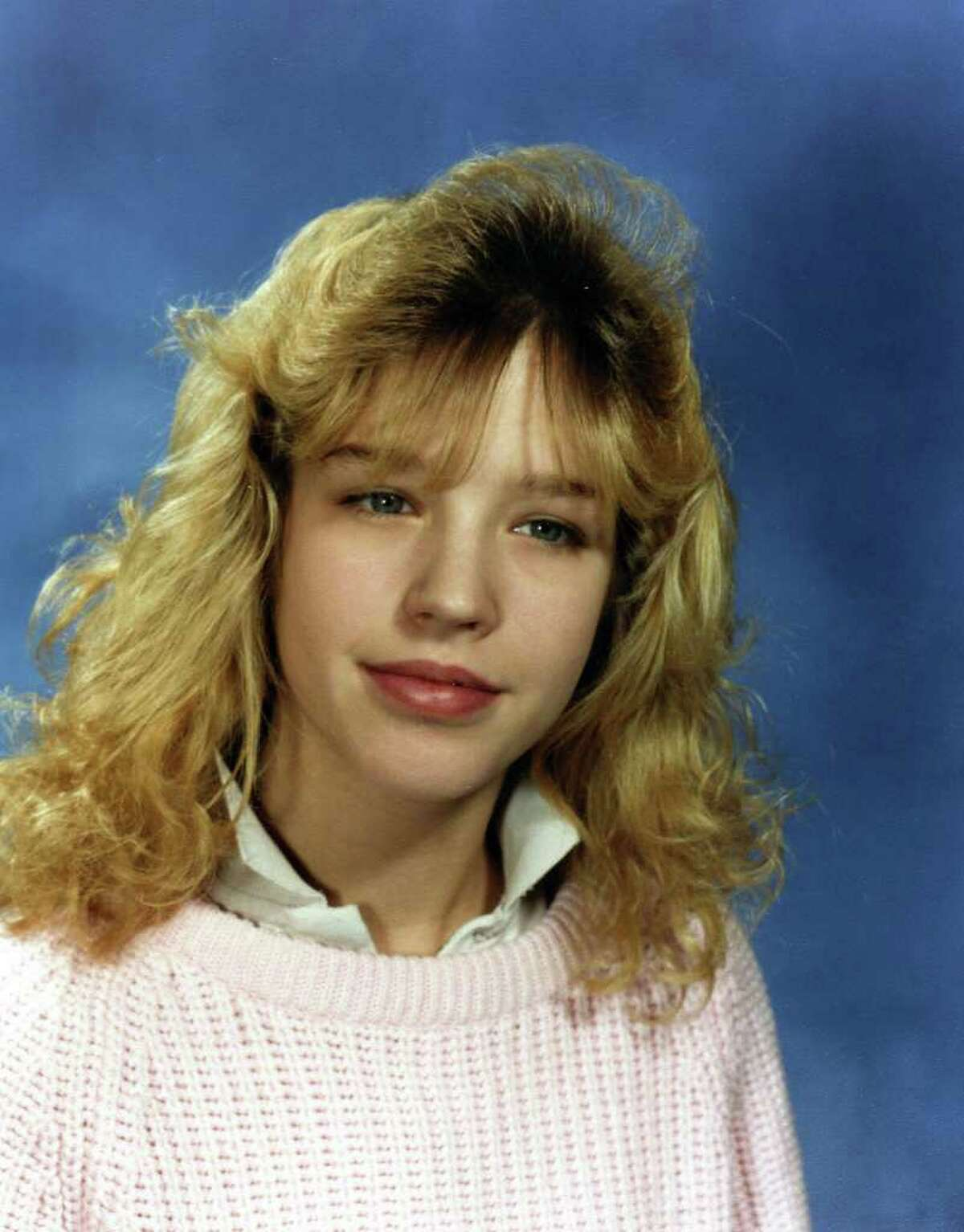 A woman, here in her 7th grade photograph, alleges that in 1990 she was drawn into a sexual relationship with Keith Raniere after he offered to tutor her in Latin and algebra.