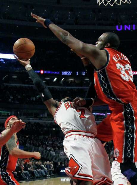 Nets forward Shelden Williams (right) blocks a shot by Bulls guard C.J. Watson during the first half. Photo: AP