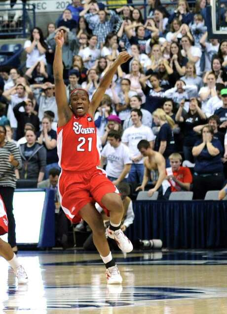 St. John's Zakiyyah Shahid-Martin celebrates after the Red Storm denied UConn its 100th consecutive home victory. Photo: AP