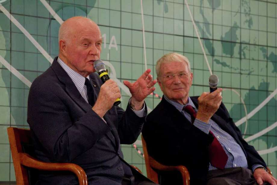 Former Sen. John Glenn, left, and Scott Carpenter, right, speak at the Kennedy Space Center, Friday, Feb. 17, 2012 in Cape Canaveral, Fla. John Glenn fever has taken hold in the U.S. once again. Three days before the 50th anniversary of his historic flight, the first American to orbit the Earth addressed employees at Kennedy Space Center. (AP Photo/Michael Brown) Photo: Mike Brown / FR170587