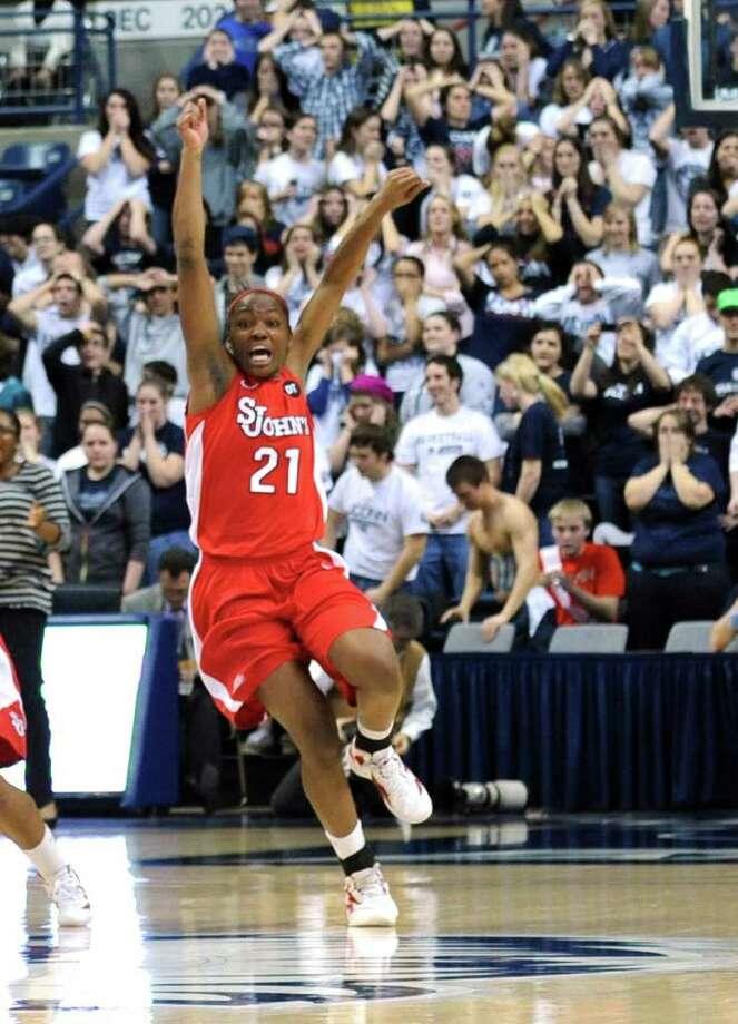 St. John's Zakiyyah Shahid-Martin celebrates at the end of an NCAA women's college basketball game against Connecticut  at Storrs, Conn., Saturday, Feb. 18, 2012. St. John's defeated Connecticut 57-56. (AP Photo/Bob Child) Photo: Bob Child, Associated Press / FR170140 AP