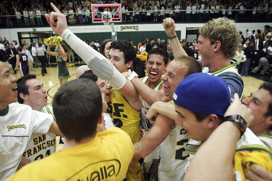 San Francisco forward Angelo Caloiaro celebrates with fans after defeating Gonzaga 66-65 in an NCAA college basketball game in San Francisco, Saturday, Feb. 18, 2012. (AP Photo/Mathew Sumner) Photo: Matt Sumner, Associated Press