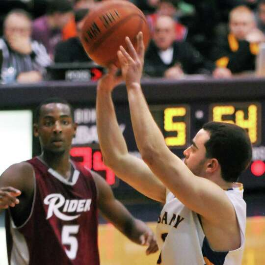 UAlbany's #0 Jacob Iati, at right, takes a shot against Rider during UAlbany's final home game of re