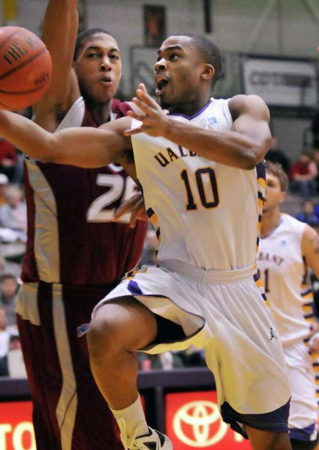UAlbany's #10 Mike Black gets by Rider's #25, Junior Fortunat, left, for two during the final home game of regular season at the SEFCU Arena in Albany Saturday Feb. 18, 2012.  (John Carl D'Annibale / Times Union) Photo: John Carl D'Annibale / 00016409A