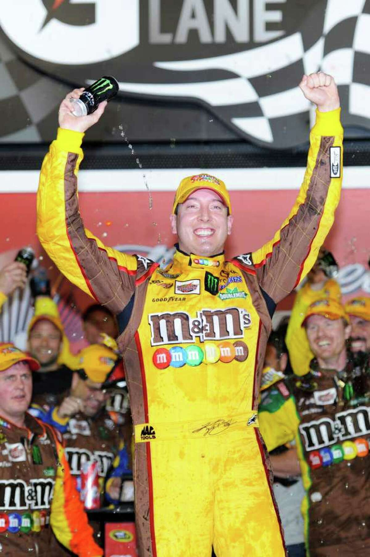 DAYTONA BEACH, FL - FEBRUARY 18: Kyle Busch, driver of the #18 M&M's Brown Toyota, celebrates in victory lane after winning the NASCAR Budweiser Shootout at Daytona International Speedway on February 18, 2012 in Daytona Beach, Florida. (Photo by John Harrelson/Getty Images for NASCAR)