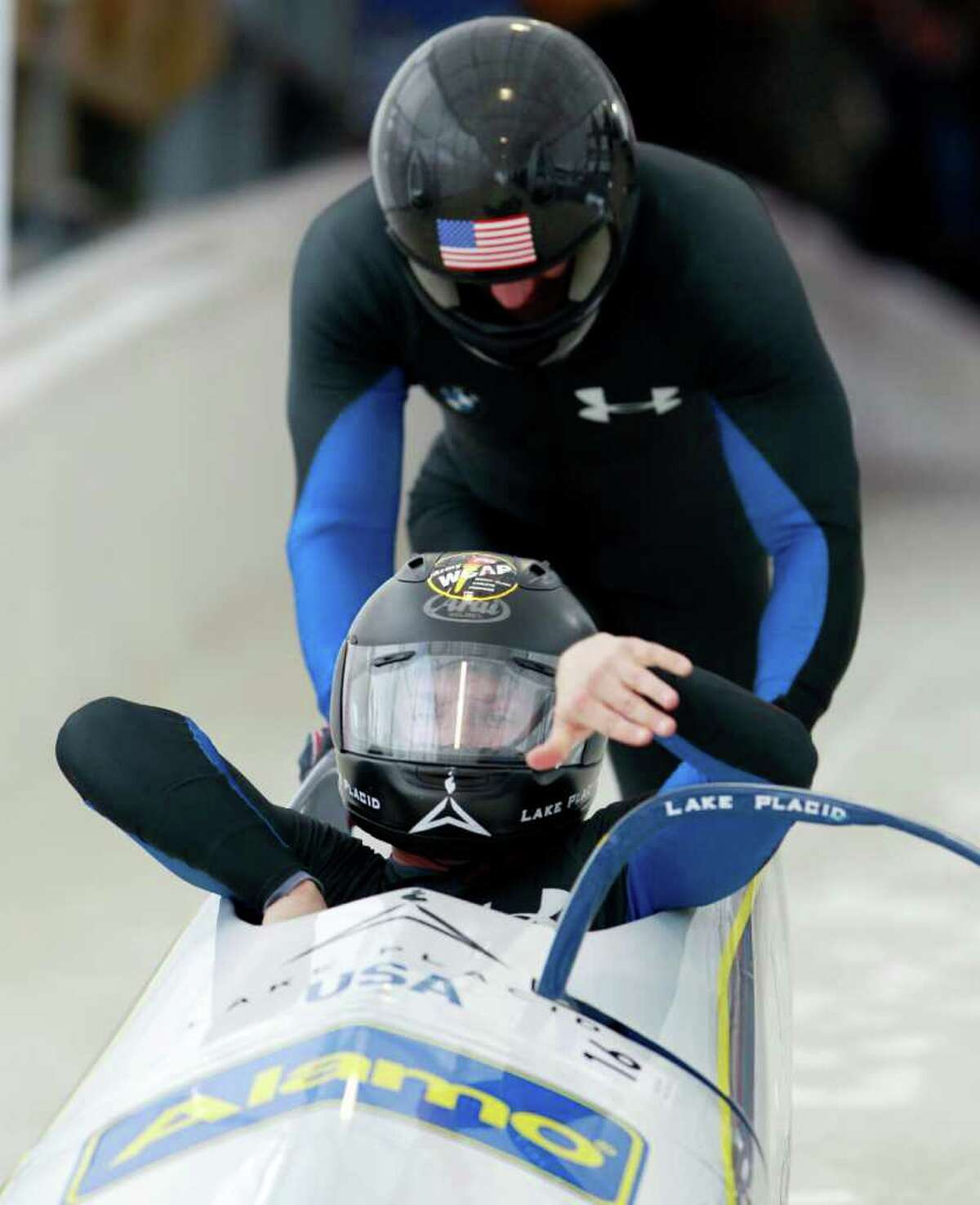 USA's John Napier, front, and Christopher Fogt start their first heat in the men's two-man bobsled world championships in Lake Placid, N.Y., on Saturday, Feb. 18, 2012. (AP Photo/Mike Groll)