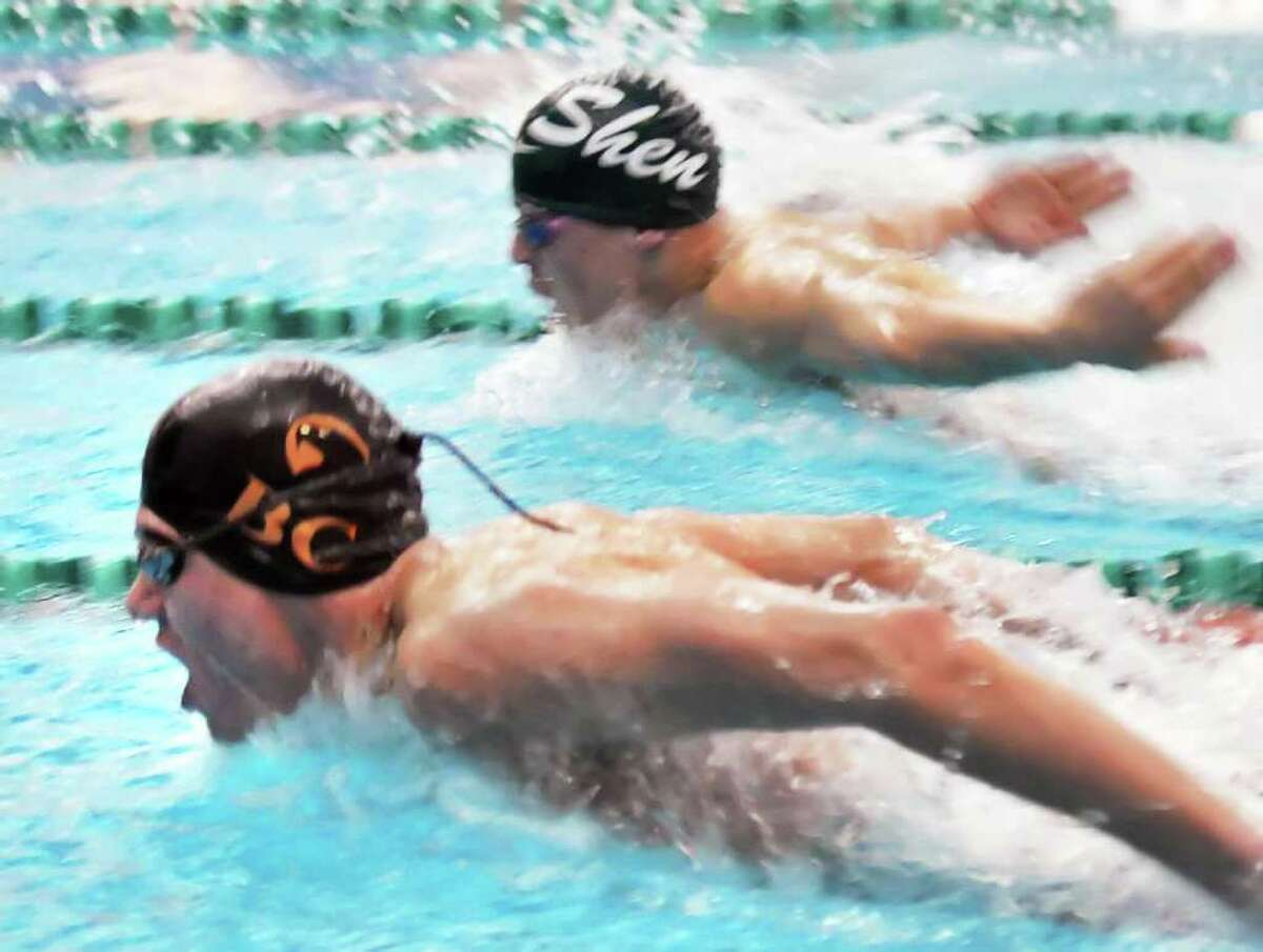 Bethlehem's Alex Lednev, left, pulls past Shen's Taylor Nichols to win the 200m individual medley at the boys' swimming sectionals at the Shenendehowa High School pool in Clifton Park Saturday Feb. 18, 2012. (John Carl D'Annibale / Times Union)