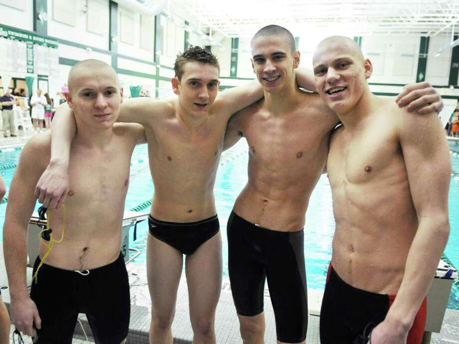 Bethlehem swimmers, from left, Kevin Flynn, Brian Negri, Gunnar Zemerong and Alex Lednev after winning the 200 Yard Medley relay at the boys' swimming sectionals at the Shenendehowa High School pool in Clifton Park Saturday Feb. 18, 2012.   (John Carl D'Annibale / Times Union) Photo: John Carl D'Annibale / 00016413A