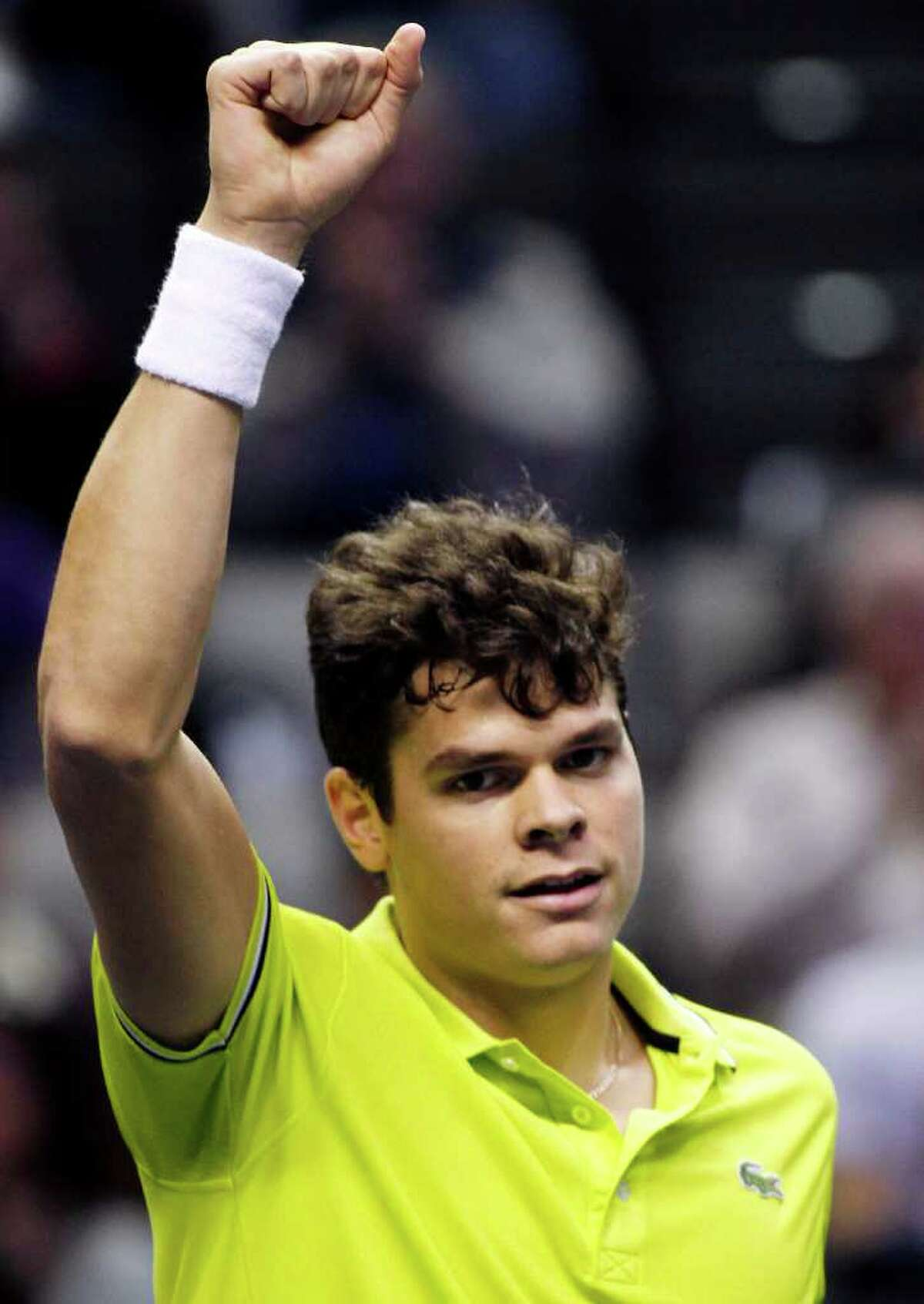 Milos Raonic reacts after defeating Ryan Harrison 7-6 (4), 6-2 in their match at the SAP Open tennis tournament in San Jose, Calif., Saturday, Feb. 18, 2012. (AP Photo/George Nikitin)