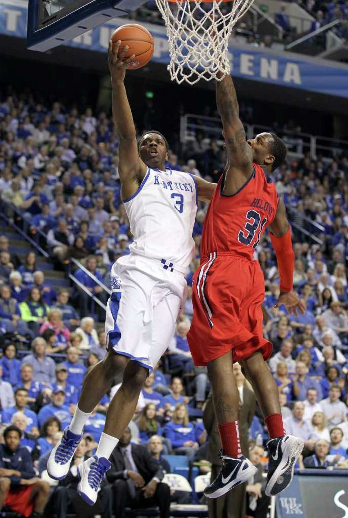 LEXINGTON, KY - FEBRUARY 18: Terrence Jones #3 of the Kentucky Wildcats shoots the ball while defended by Murphy Holloway #31 of the Ole Miss Rebels during the game at Rupp Arena on February 18, 2012 in Lexington, Kentucky. (Photo by Andy Lyons/Getty Images)