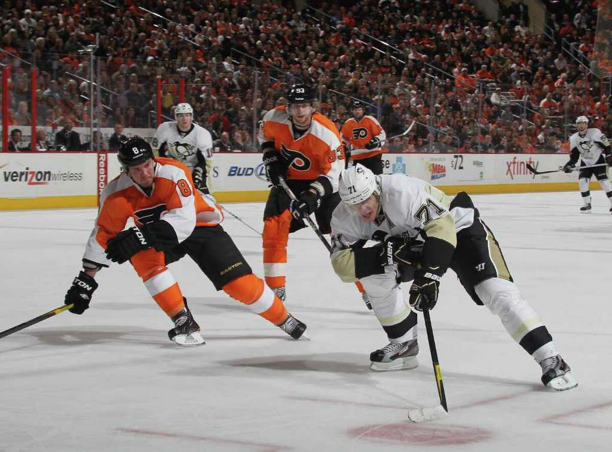 PHILADELPHIA, PA - FEBRUARY 18: Evgeni Malkin #71 of the Pittsburgh Penguins tires to move past Nicklas Grossman #8 of the Philadelphia Flyers at the Wells Fargo Center on February 18, 2012 in Philadelphia, Pennsylvania. (Photo by Bruce Bennett/Getty Images)
