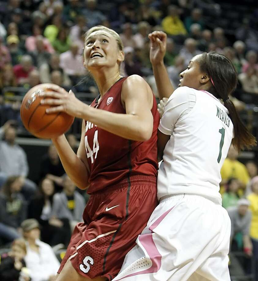 Stanford's Joslyn Tinkle, left, works for position under the basket against Oregon's Deanna Weaver on her way to a team-high 19 points in an NCAA college basketball game on Saturday, Feb. 18, 2012, in Eugene, Ore. (AP Photo/Chris Pietsch) Photo: Chris Pietsch, Associated Press