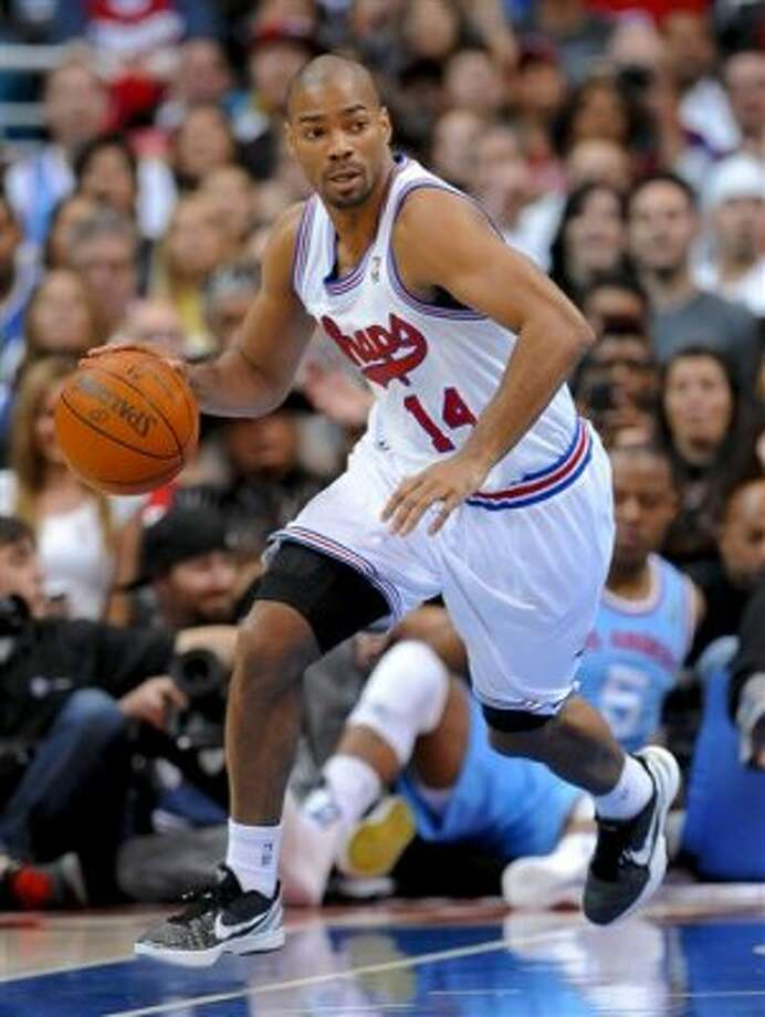 San Antonio Spurs guard Gary Neal brings the ball up in the second half of an NBA basketball game against the Los Angeles Clippers, Saturday, Feb. 18, 2012, in Los Angeles. The Spurs won 103-100 in overtime. (AP Photo/Gus Ruelas) (AP)