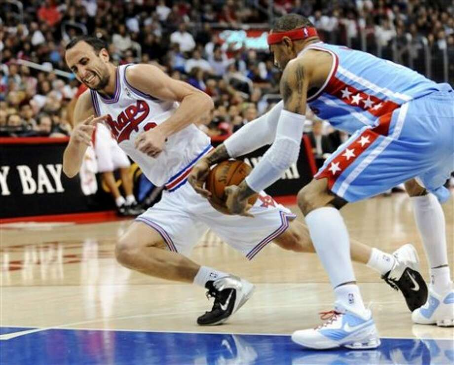 Los Angeles Clippers guard Kenyon Martin, right, steals the ball from Spurs guard Manu Ginobili, left, in the second half of an NBA basketball game, Saturday, Feb. 18, 2012, in Los Angeles. The Spurs won 103-100 in overtime. (AP Photo/Gus Ruelas) (ASSOCIATED PRESS)