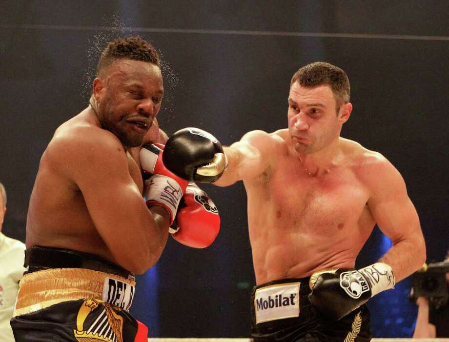WBC heavyweight Champion Vitali Klitschko of Ukraine, right, punches challenger Dereck Chisora of Britain during their bout Saturday in Munich. Photo: Frank Augstein / AP