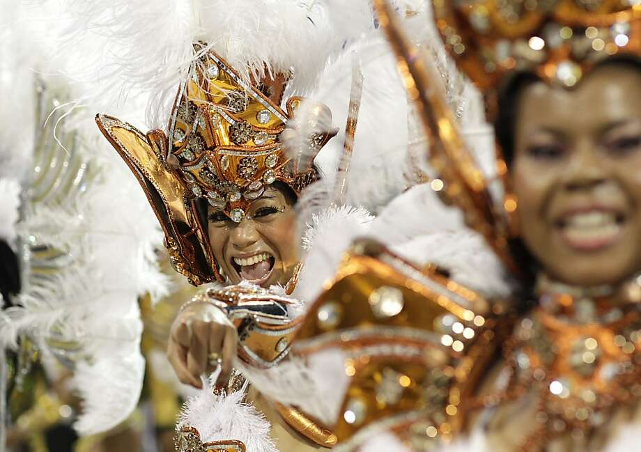 A dancer performs during the parade of  Vai-Vai samba school in Sao Paulo, Brazil, Saturday, Feb. 18, 2012. (AP Photo/Andre Penner) Photo: Andre Penner, Associated Press