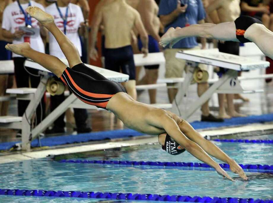 Texas Military Institute's Jac Clark dives at the start of the 50 yard freestyle at the 2012 TAPPS State Championship swim meet at Davis Natatorium on Saturday, Feb. 18, 2012. Kin Man Hui/San Antonio Express-News Photo: Kin Man Hui, Express-News / San Antonio Express-News