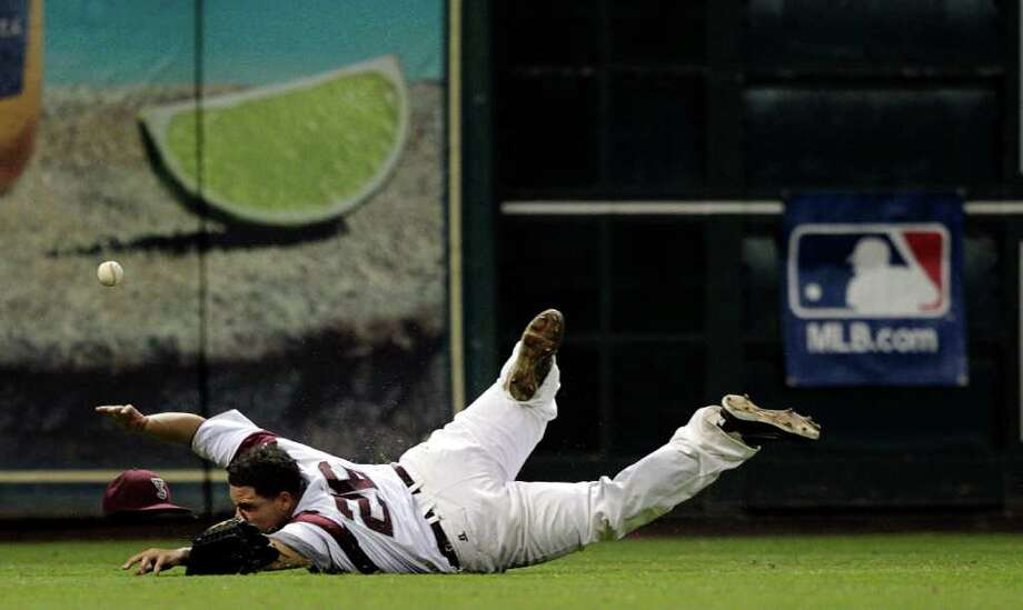TSU right fielder Miko Bernstine #26 makes a diving attempt on a fly ball against Prairie View during a baseball game between Prairie View and Texas Southern as part of the Urban Invitational Saturday, Feb. 18, 2012 at Minute Maid Park. Photo: Bob Levey, Houston Chronicle / ©2012 Bob Levey