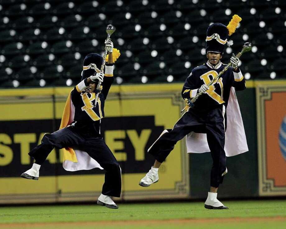 Prairie View Marching Band drum majors perform during a pre-game battle of the bands with the TSU Ocean of Soul during a baseball game between Prairie View and Texas Southern as part of the Urban Invitational Saturday, Feb. 18, 2012 at Minute Maid Park. Photo: Bob Levey, Houston Chronicle / ©2012 Bob Levey