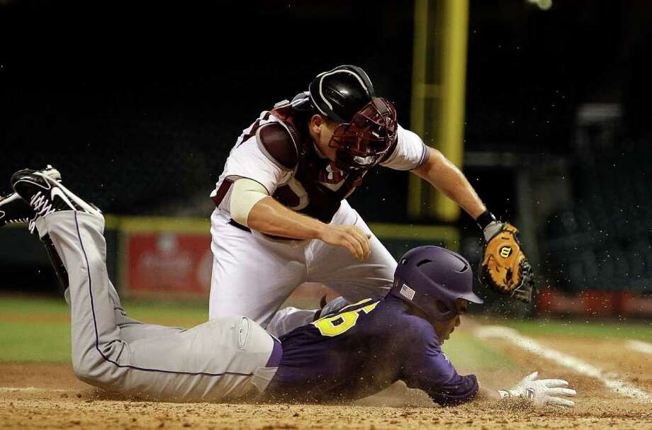 Prairie View's Darryl Johnson (16) is tagged out by TSU catcher Shane Lefteley (7) as he attempted to score on an inside the park home run during a baseball game between Prairie View and Texas Southern as part of the Urban Invitational Saturday, Feb. 18, 2012 at Minute Maid Park. Photo: Bob Levey, Houston Chronicle / ©2012 Bob Levey