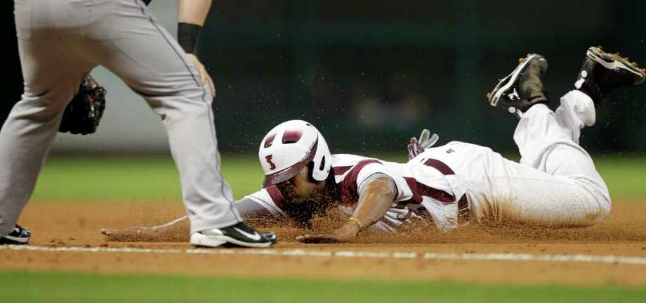 TSU's Cameron Logan #27 slides head first into third base during a baseball game between Prairie View and Texas Southern as part of the Urban Invitational Saturday, Feb. 18, 2012 at Minute Maid Park. Photo: Bob Levey, Houston Chronicle / ©2012 Bob Levey