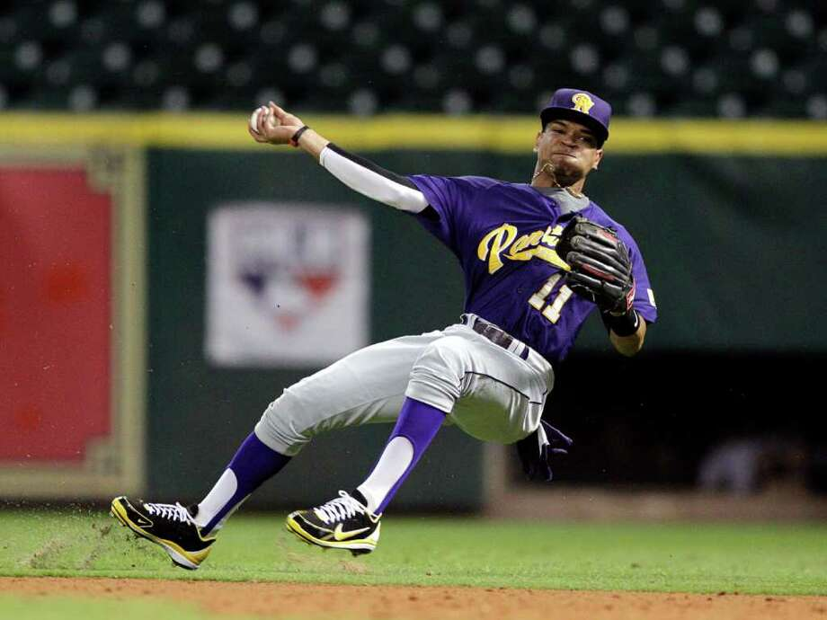 Prairie View second baseman Andre Oliver #11 throws off balance after tracking down a hard hit ball in the hole during a baseball game between Prairie View and Texas Southern as part of the Urban Invitational Saturday, Feb. 18, 2012 at Minute Maid Park. Photo: Bob Levey, Houston Chronicle / ©2012 Bob Levey