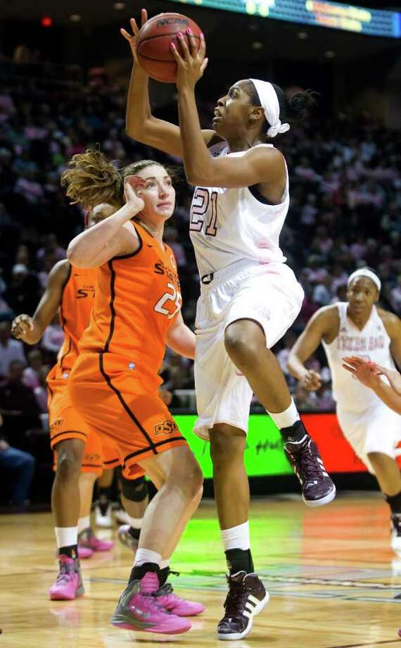 Texas A&M's Adaora Elonu, right, shoots past Oklahoma State's Lindsey Keller during the first half of an NCAA college basketball game, Saturday, Feb. 18, 2012, in College Station, Texas. (AP Photo/Bryan-College Station Eagle, Stuart Villanueva) Photo: Stuart Villanueva, Associated Press / Bryan-College Station Eagle