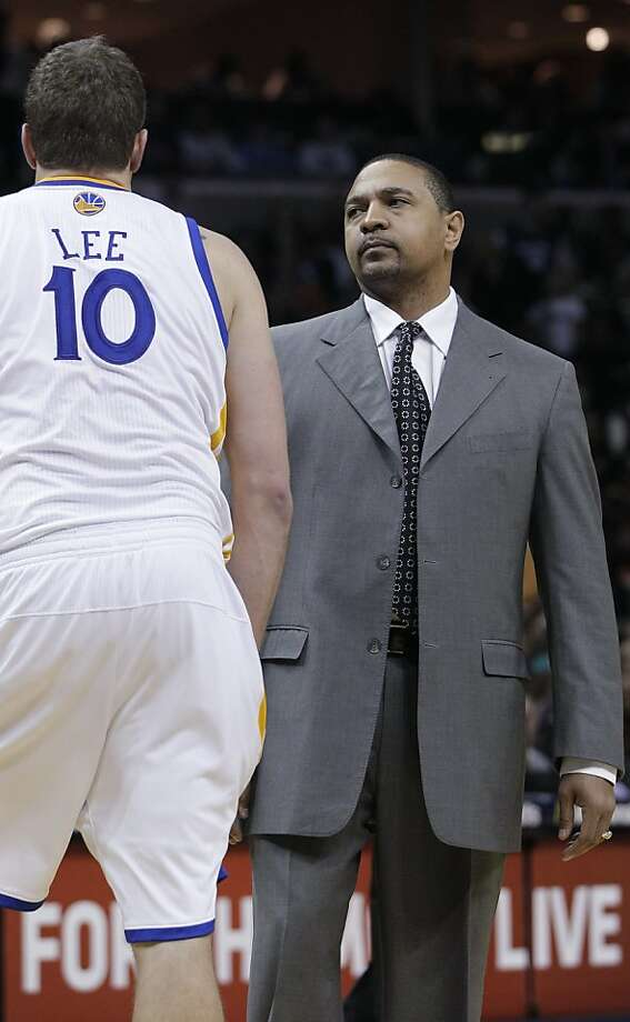 Golden State Warriors coach Mark Jackson, right, talks with forward David Lee during the second half of an NBA basketball game in Memphis, Tenn., Saturday, Feb. 18, 2012. Memphis defeated Golden State 104-103. Photo: Danny Johnston, Associated Press