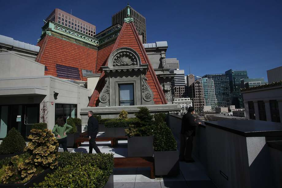 The 11th floor terrace of One Kearny provides a unique glimpse of the regal mansard roof of the 1906 landmark to which it is attached Photo: Liz Hafalia, The Chronicle