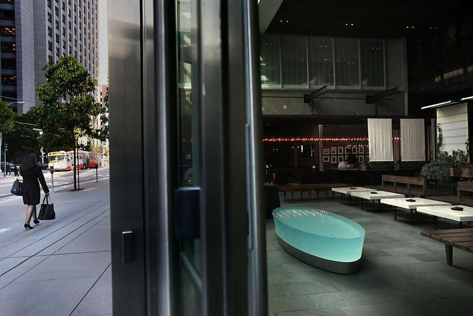 One of the publicly owned private spaces open to passers-by is the enclosed plaza at the Millennium Tower in the Financial District. Photo: Liz Hafalia, The Chronicle