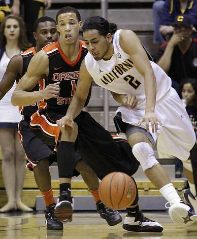 California's Jorge Gutierrez, right, drives the ball against Oregon State's Jared Cunningham (1) during the first half of an NCAA college basketball game on Saturday, Feb. 18, 2012, in Berkeley, Calif. Photo: Ben Margot, Associated Press