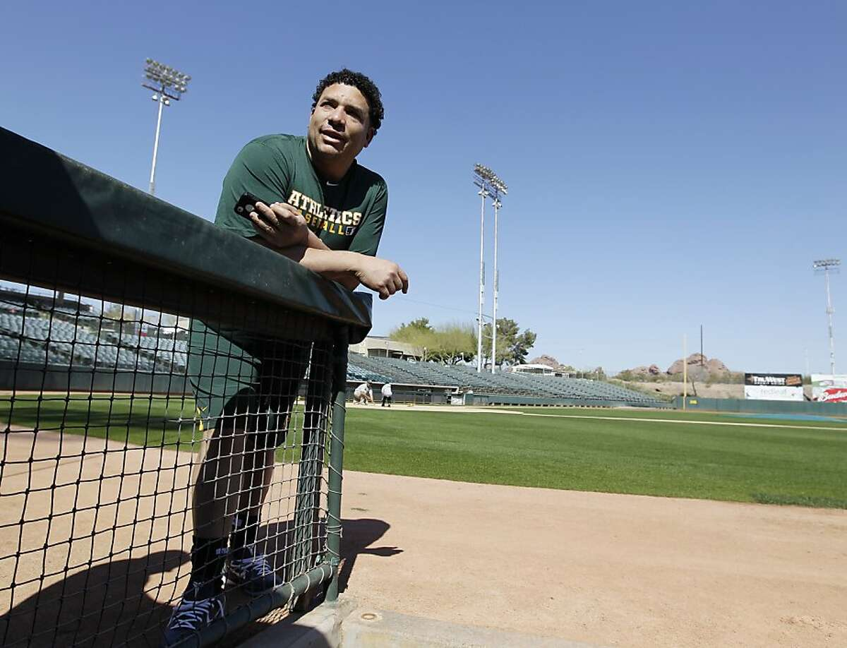 Oakland Athletics' Bartolo Colon talks with fans after arriving for spring training baseball, Saturday, Feb. 18, 2012 in Phoenix. (AP Photo/Darron Cummings)