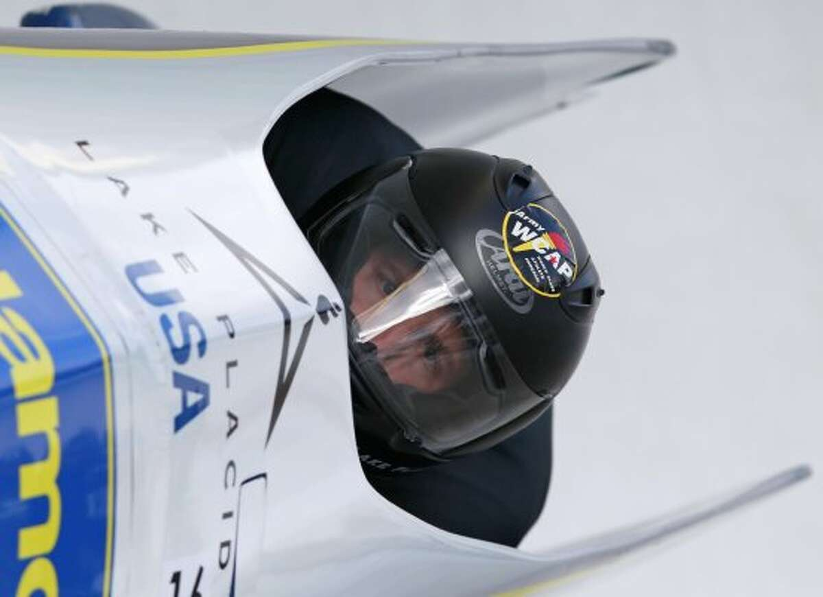 Schenectady's John Napier pilots with brakeman Christopher Fogt as they compete in the second heat in the men's two-man bobsled world championships in Lake Placid, N.Y., on Saturday, Feb. 18, 2012. (AP Photo/Mike Groll) (AP)