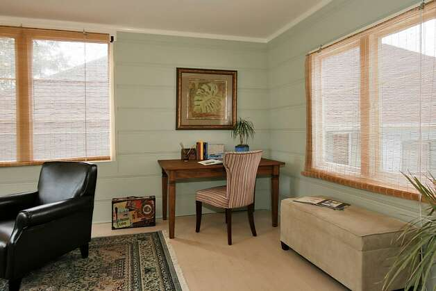 The multiuse bonus space is ideal for use as a den or home office, providing ample views of the manicured lawns. Photo: Liz Rusby