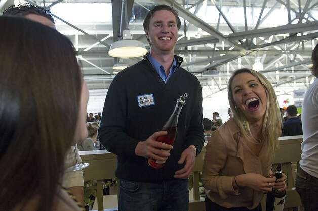 Mike Benziger of Envolve Winery and his sister Kate Benziger have a laugh as they serve their wine during the San Francisco Chronicle Wine Competition, Saturday February 18, 2012 in San Francisco, Calif. Photo: David Paul Morris, Special To The Chronicle
