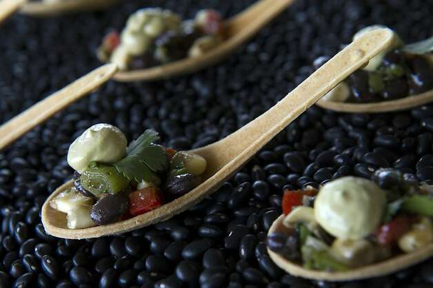A black bean salad with an avocado crema on a lime and corn infused spoon is displayed during the San Francisco Chronicle Wine Competition, Saturday February 18, 2012 in San Francisco, Calif. Photo: David Paul Morris, Special To The Chronicle