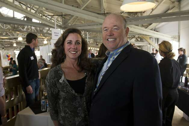 Mark Adkins, president of the San Francisco Chronicle and his wife Melanie Adkins pose for a photograph during the San Francisco Chronicle Wine Competition, Saturday February 18, 2012 in San Francisco, Calif. Photo: David Paul Morris, Special To The Chronicle