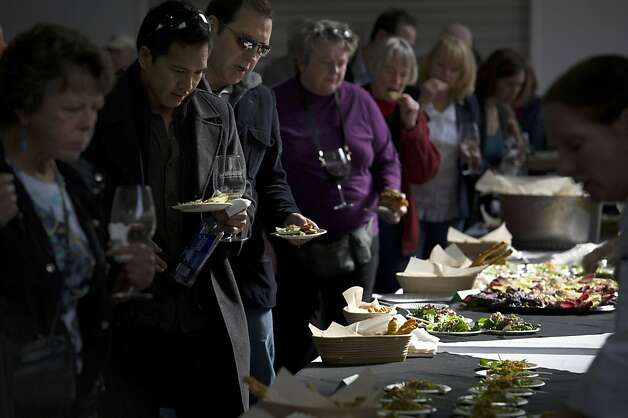 Patrons samples some of the food offered during the San Francisco Chronicle Wine Competition, Saturday February 18, 2012 in San Francisco, Calif. Photo: David Paul Morris, Special To The Chronicle