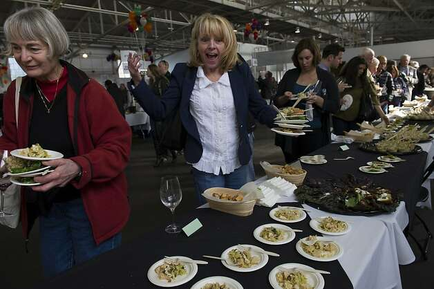 Sally Chenault of Fresno loads up on the small plates of food during the San Francisco Chronicle Wine Competition, Saturday February 18, 2012 in San Francisco, Calif. Photo: David Paul Morris, Special To The Chronicle