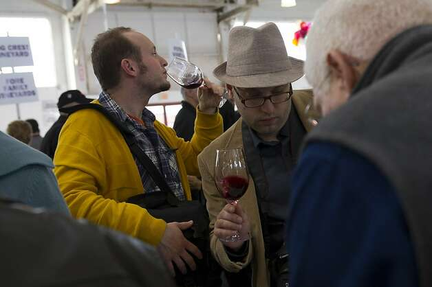 Daniel Erickson, left, samples some wine as Brian Lasofsky, a wine and food blogger, checks out some bottles of wine during the San Francisco Chronicle Wine Competition, Saturday February 18, 2012 in San Francisco, Calif. Photo: David Paul Morris, Special To The Chronicle