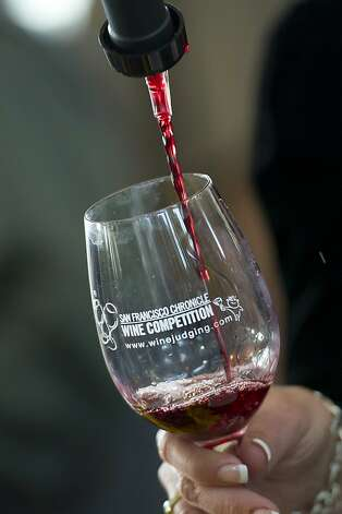 Wine is poured into a glass during the San Francisco Chronicle Wine Competition, Saturday February 18, 2012 in San Francisco, Calif. Photo: David Paul Morris, Special To The Chronicle