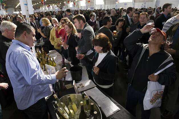 Ron Carbullido, right, finishes off his wine as his fiance Annette Sklarenitis looks at her glass of wine during the San Francisco Chronicle Wine Competition, Saturday February 18, 2012 in San Francisco, Calif. Photo: David Paul Morris, Special To The Chronicle